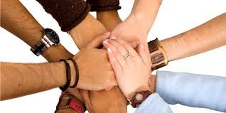 group linking hands with each other